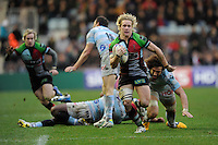 Matt Hopper of Harlequins accelerates past Camille Gerondeau of Racing Metro 92 during the Heineken Cup match between Harlequins and Racing Metro 92 at the Twickenham Stoop on Sunday 15th December 2013 (Photo by Rob Munro)
