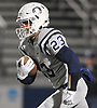 Derek Cruz #23 of Oceanside races upfield during the Nassau County Conference I varsity football semifinals against Farmingdale at Hofstra University on Saturday, Nov. 11, 2017.