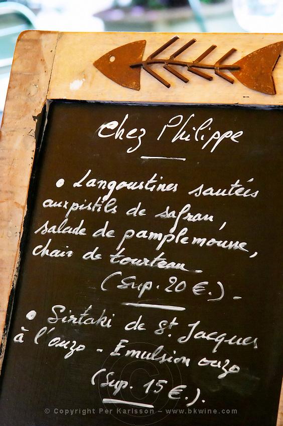 Restaurant Chez Philippe. The menu on a chalk board. Marseillan. Languedoc. France. Europe.
