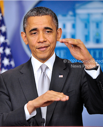 United States President Barack Obama answers reporter's questions after making a statement about how his administration will pursue a Weapons control policy in the wake of the Newtown tragedy in the Brady Press Briefing Room on Wednesday, December 19, 2012. .Credit: Ron Sachs / CNP