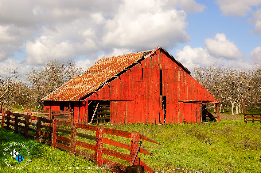 A broken old barn sits on an abandoned farm in the California central valley