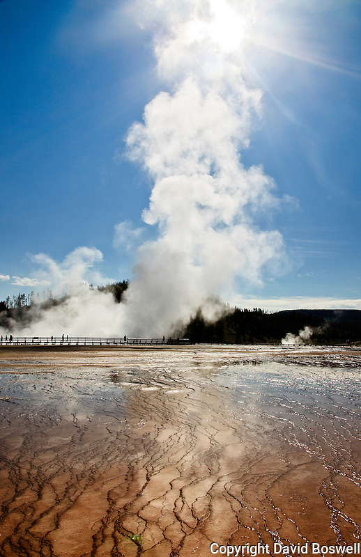 The sun shines through the steam at Midway Geyser Basin, Yellowstone National Park.