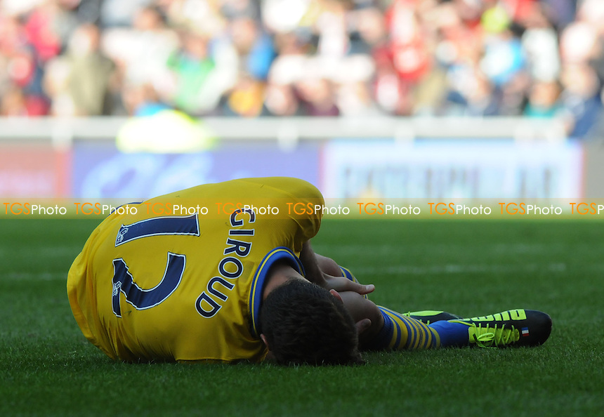 Olivier Giroud of Arsenal goes down injured - Sunderland vs Arsenal - Barclays Premier League Football at the Stadium of Light, Sunderland - 14/09/13 - MANDATORY CREDIT: Steven White/TGSPHOTO - Self billing applies where appropriate - 0845 094 6026 - contact@tgsphoto.co.uk - NO UNPAID USE<br />   i