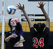 Emma Schlagheck, Wixom St. Catherine, goes up for a kill over the outstretched arms of Sydney Moore (24), Detroit Edison, during regional final volleyball action at Bishop Foley High School Thursday, Nov. 9, 2017. St. Catherines defeated Edison 3-0. Photos: Larry McKee, L McKee Photography. PLEASE NOTE: ALL PHOTOS ARE CUSTOM CROPPED. BEFORE PURCHASING AN IMAGE, PLEASE CHOOSE PROPER PRINT FORMAT TO BEST FIT IMAGE DIMENSIONS. L McKee Photography, Clarkston, Michigan. L McKee Photography, Specializing in Action Sports, Senior Portrait and Multi-Media Photography. Other L McKee Photography services include business profile, commercial, event, editorial, newspaper and magazine photography. Oakland Press Photographer. North Oakland Sports Chief Photographer. L McKee Photography, serving Oakland County, Genesee County, Livingston County and Wayne County, Michigan. L McKee Photography, specializing in high school varsity action sports and senior portrait photography.