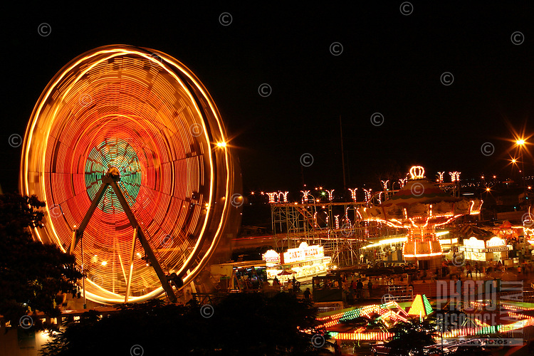 Long-exposure photo of the 50th State Fair held every year at the Aloha Stadium parking lot.  Ferris wheel spinning out of conrol.
