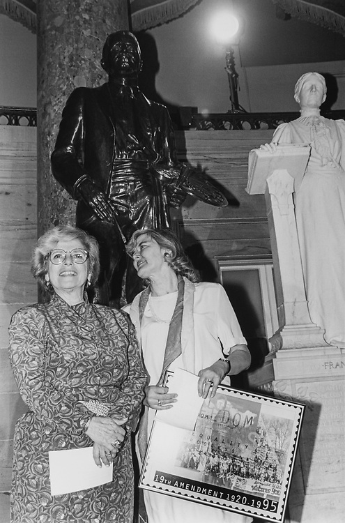 Rep. Marge Roukema, R-N.J., with Rep. Patricia Schroeder, D-Colo., at the 75th Anniversary of Woman's Suffrage reception at the National Statuary Hall, Rep. Schroeder holding a picture of commemorative stamp, on Sep. 13, 1995. (Photo by CQ Roll Call via Getty Images)