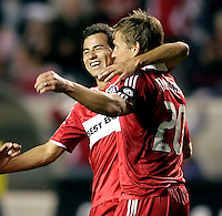 Chicago Fire forward Brian McBride (20) gets a hug from midfielder Marco Pappa (16) after McBride scored the game's first goal.  The Chicago Fire tied the Kansas City Wizards 2-2 at Toyota Park in Bridgeview, IL on April 18, 2009.