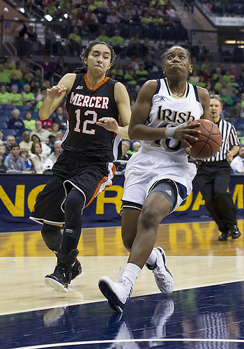 November 20, 2012:  Notre Dame guard Kaila Turner (15) goes up for a shot as Mercer guard Jessica Prieto (12) defends during NCAA Women's Basketball game action between the Notre Dame Fighting Irish and the Mercer Bears at Purcell Pavilion at the Joyce Center in South Bend, Indiana.  Notre Dame defeated Mercer 93-36.