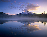 Mt. Hood and clouds mirrored on Trillium Lake at sunrise, Mt. Hood Wilderness Area, Oregon, USA.