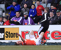 Dan Potts of Luton Town goes down after a late and heavy challenge resulting in him being stretched off during the Sky Bet League 2 match between Plymouth Argyle and Luton Town at Home Park, Plymouth, England on 19 March 2016. Photo by Liam Smith.