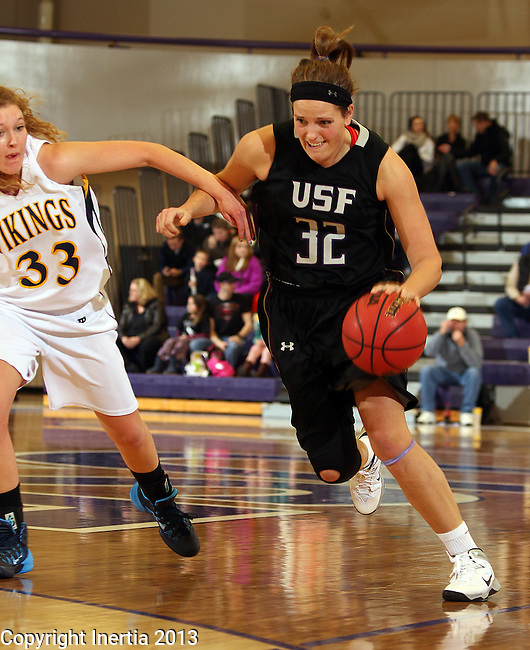 SIOUX FALLS, SD - DECEMBER 7:  Laura Johnson #32 from the University of Sioux Falls tries to get a step past Hayley McCarron #33 from Augustana in the second half of their game Saturday evening at the Stewart Center. (Photo by Dave Eggen/Inertia)