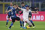 Alberto Cerri of Cagliari clashes with Nicolo Barella and Andrea Ranocchia of Inter during the Coppa Italia match at Giuseppe Meazza, Milan. Picture date: 14th January 2020. Picture credit should read: Jonathan Moscrop/Sportimage