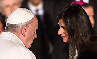 Pope Francis greets Rome's Mayor Virginia Raggi after presiding over the Via Crucis (Way of the Cross) on Good Friday, in front of the Colosseum, in Rome, March 30, 2018.<br /> UPDATE IMAGES PRESS/Riccardo De Luca<br /> <br /> STRICTLY ONLY FOR EDITORIAL USE