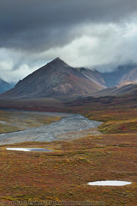 Clouds hang over the Alaska mountain range near Polychrome Pass, Denali National Park, interior.