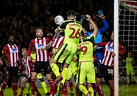 Bolton Wanderers' Liam Edwards (centre) heads across goal from a corner kick<br /> <br /> Photographer Andrew Kearns/CameraSport<br /> <br /> The EFL Sky Bet League One - Lincoln City v Bolton Wanderers - Tuesday 14th January 2020  - LNER Stadium - Lincoln<br /> <br /> World Copyright © 2020 CameraSport. All rights reserved. 43 Linden Ave. Countesthorpe. Leicester. England. LE8 5PG - Tel: +44 (0) 116 277 4147 - admin@camerasport.com - www.camerasport.com
