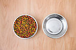 Bowl of dog food and  water on wooden floor