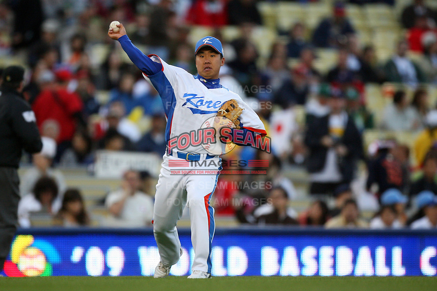 Bum Ho Lee of Korea during a game against Japan at the World Baseball Classic at Dodger Stadium on March 23, 2009 in Los Angeles, California. (Larry Goren/Four Seam Images)