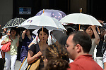 July 16, 2014, Tokyo, Japan - A parasol is a must item for a woman as an early summer heat bakes Tokyo with the temperature soaring as high as nearly 90 degrees Fahrenheit.  (Photo by Natsuki Sakai/AFLO)