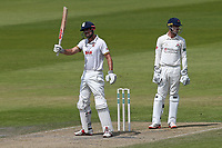 Alastair Cook of Essex raises his bat to celebrate reaching his fifty during Lancashire CCC vs Essex CCC, Specsavers County Championship Division 1 Cricket at Emirates Old Trafford on 10th June 2018
