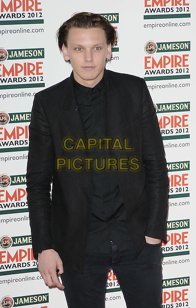 Jamie Campbell Bower.Jameson Empire Film Awards at the Grosvenor House Hotel, Park Lane, London, England..March 25th 2012.full length black suit shirt  hand in pocket   .CAP/CAN.©Can Nguyen/Capital Pictures.