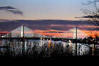 Sunset illuminates the sky behind the the Bill Emerson Memorial Bridge in Cape Girardeau, Mo., on Nov. 28, 2010.