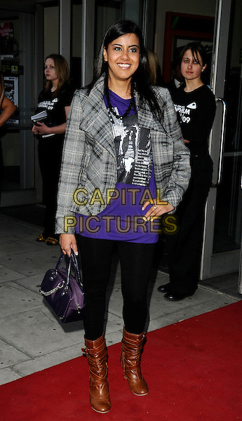 "POOJA SHAH .At the ""City Rats"" East End Film Festival VIP Screening, Genesis Cinema, Mile End Road, London, England, UK, .April 24th 2009..full length purple top checked plaid grey gray black jacket legging brown boots bag hand on hip .CAP/CAN.©Can Nguyen/Capital Pictures"