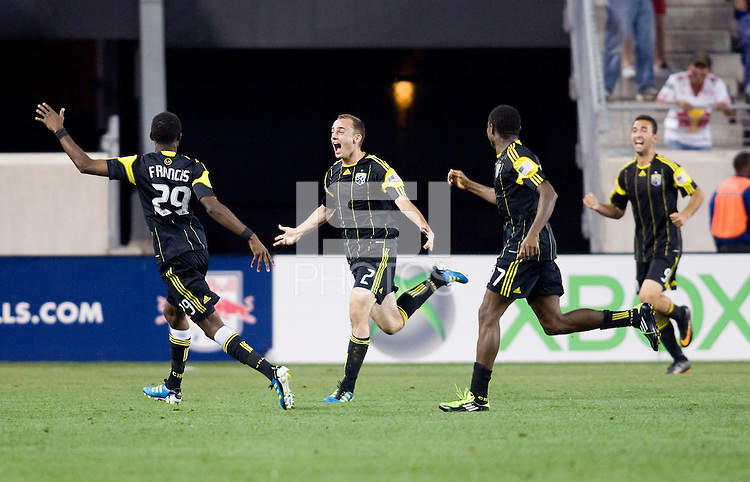 Rich Balchan (2) of the Columbus Crew celebrates his game tying goal with teammates Shaun Francis and Emmanuel Ekpo during the game at Red Bull Arena in Harrison, NJ.  The New York Red Bulls tied the Columbus Crew, 1-1.