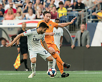 FOXBOROUGH, MA - JUNE 29: Carles Gil #22 shields ball from Tommy McNamara #11 during a game between Houston Dynamo and New England Revolution at Gillette Stadium on June 29, 2019 in Foxborough, Massachusetts.