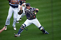 Canisius College Golden Griffins catcher Christ Conley (13) throws to first base during the first game of a doubleheader against the Michigan Wolverines on February 20, 2016 at Tradition Field in St. Lucie, Florida.  Michigan defeated Canisius 6-2.  (Mike Janes/Four Seam Images)