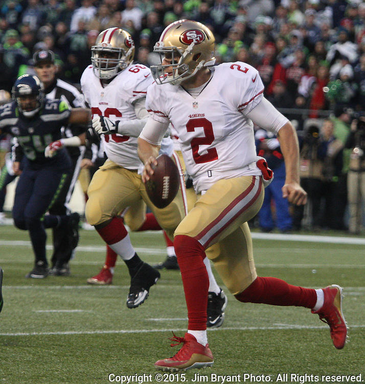 San Francisco 49ers quarter Blaine Gabbert (2) scrambles agains the Seattle Seahawks at CenturyLink Field in Seattle, Washington on November 22, 2015.  The Seahawks beat the 49ers 29-13.   ©2015. Jim Bryant Photo. All RIghts Reserved.