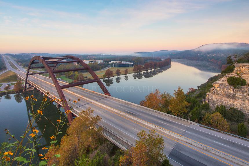 Pennybacker Bridge outside of Austin, Texas, crosses the still Colorado Rivver on a cold December morning.