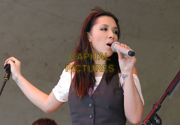 "THE WRECKERS - MICHELLE BRANCH.Bring their ""Stand Still, Look Pretty"" tour to the VB Bike Classic, Virginia Beach, Virginia, USA..April 21st, 2007.half length stage concert live gig performance music  singing tattoos right left .CAP/ADM/MK.©Mike Kline/AdMedia/Capital Pictures"