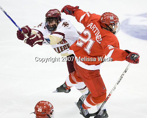 Andrew Orpik (Boston College - East Amherst, NY) and Alec Martinez (MiamiU - Rochester, MI) - The Boston College Eagles defeated the Miami University Redhawks 4-0 in the 2007 NCAA Northeast Regional Final on Sunday, March 25, 2007 at the Verizon Wireless Arena in Manchester, New Hampshire.