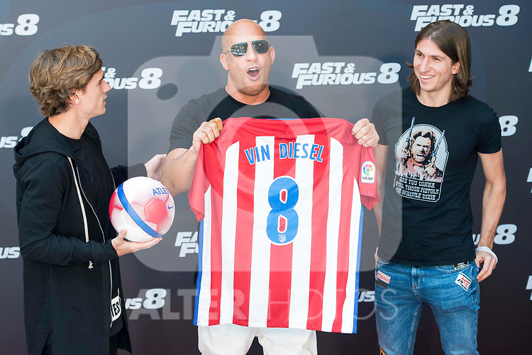 American actor Vin Diesel with Atletico de Madrid's player Antoine Griezmann (L) and Filipe Luis (R) during the presentation of the film &quot;Fast &amp; Furious 8&quot; at Hotel Villa Magna in Madrid, April 06, 2017. Spain.<br /> (ALTERPHOTOS/BorjaB.Hojas)