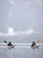 Jennifer Johnston, left, of Bothell and Judy Robb of Bothell paddle their way across Baker Lake near Concrete, Wash., Friday Sept. 28, 2007.