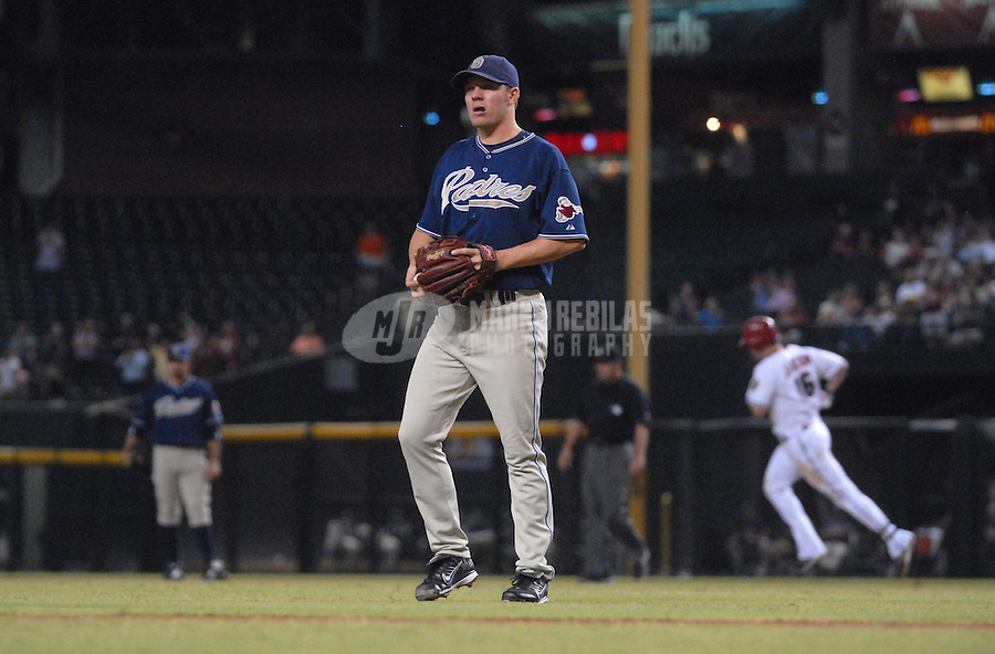 Sept 5, 2007; Phoenix, AZ, USA; San Diego Padres pitcher (44) Jake Peavy reacts after giving up a first inning two run home run to Arizona Diamondbacks first baseman (16) Conor Jackson at Chase Field. Mandatory Credit: Mark J. Rebilas-US PRESSWIRE