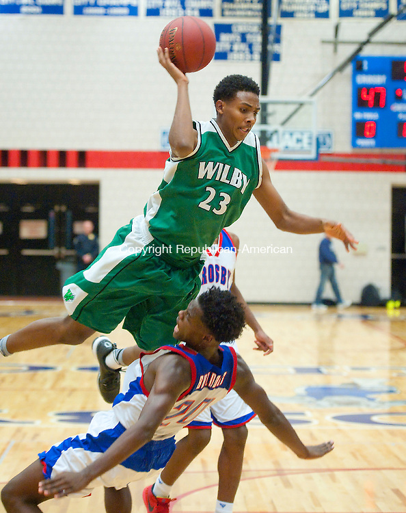 WATERBURY, CT--- -123015JS14--Wilby's Ahmad Alves (23) is called for a charge while driving to the basket on Crosby's Dan Jones (20) during their game Wednesday at Crosby High School. Wilby defeated the Bulldogs 79-77. <br /> Jim Shannon Republican-American