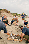 Mark Dodd, DNR Sea Turtle Program Coordinator, talks about data collection to AmeriCorps research members on the beach of Jekyll Island, Georgia at dawn August 15, 2013.