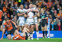 Picture by Allan McKenzie/SWpix.com - 07/10/2017 - Rugby League - Betfred Super League Grand Final - Castleford Tigers v Leeds Rhinos - Old Trafford, Manchester, England - Leeds's Tom Briscoe is congratulated on scoring a try against Castleford.