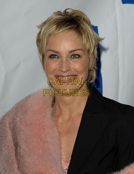 """SHARON STONE.Is honored as an """"Angel"""" at Project Angel Food's Angel Awards Gala held at Project Angel Food in West Hollywood, California,.August 21st 2004..portraoit headshot pink fur stole wrap black suit.Ref: DVS.www.capitalpictures.com.sales@capitalpictures.com.©Capital Pictures."""