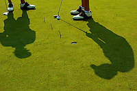 Drew Smith and John McDonald do a putting drill on the practice green during FHS Golf Practice August 1, 2005 at Stonewall Golf Club in Gainsville, VA.