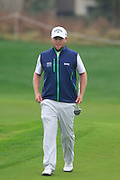 Branden Grace (RSA) walks onto the 9th green during Thursday's Round 1 of the 2014 BMW Masters held at Lake Malaren, Shanghai, China 30th October 2014.<br /> Picture: Eoin Clarke www.golffile.ie