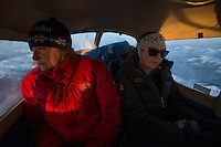 Skiku coaches Hannah, left, and Anna, right, on their way to Sleetmute and Stony River in the back of a Cessna 172. Skiku is a non-profit organization with the mission of creating a sustainable Nordic ski program in communities throughout Alaska. Volunteer coaches travel to villages each spring to instruct youngsters and distribute donated equipment with the goal of establishing ski programs at rural schools.  Photo by James R. Evans