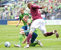 Seattle Sounders FC defender Tyson Wahl gets position on Colorado Rapids forward Caleb Folan during play at CenturyLink Field in Seattle Saturday July 16, 2011. The Sounders won the game 4-3.