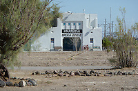 Amargosa Opera House, Death Valley Junction, California. Front Elevation about 150' away. Interior of this unique and special architectural and cultural treasure. Restored as a performance space by Marta Becket in 1968. Part of the Hotel Complex originally built as a mining housing project in 1923-25. Live Theater continues here with Marta performing shows on occasion.
