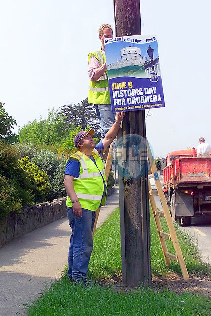 Corporation staff members erecting the posters on all road in and out of the town. the posters are to promote the town after the By-pass is opened on June 9th. Posters were designed by caoimhe Mulroy of Once upon a design and pictures were by Fran caffrey of Newsfile..Photo Fran Caffrey/Newsfile.ie..This picture has been sent to you by:.Newsfile Ltd,.3 The View,.Millmount Abbey,.Drogheda,.Co Meath..Ireland..Tel: +353-41-9871240.Fax: +353-41-9871260.GSM: +353-86-2500958.ISDN: +353-41-9871010.IP: 193.120.102.198.www.newsfile.ie..email: pictures@newsfile.ie..This picture has been sent by Fran Caffrey.francaffrey@newsfile.ie