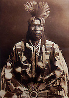 BNPS.co.uk (01202 558833)<br /> Pic: Bloomsbury/BNPS<br /> <br /> Young man of the Piegan tribe in 1900.<br /> <br /> Lost souls - Poignant archive reveals the lost tribes of North America in beautiful photographs from just over a century ago.<br /> <br /> A remarkable collection of photographs which give an unprecedented insight into the lives of Native Americans at a time when their land was being taken from them have emerged at auction.<br /> <br /> Between 1907 and 1930, US photographer Edward Curtis spent time with more than 80 native tribes across Native America, taking thousands of photographs as part of his groundbreaking The North American Indian project.<br /> <br /> A collection of more than 500 rare Curtis photographs are being auctioned off later this month and are expected to fetch over &pound;300,000.