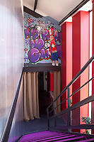 The mural on a wall facing the metal staircase has been painted in homage to the 1980s New York street scene