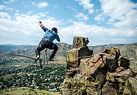 Working with experts at Rocky Mountain Slackline, The Adventurist columnist, Clint Carter  attempts a highline walk at North Tale Mountain in Golden, Colorado, Tuesday, August 29, 2017. Carter take on a vertigo-inducing highline that stretches across a traverse after only 4 days of training.<br /> <br /> Photo by Matt Nager