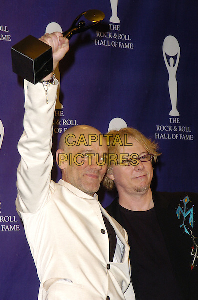 MICHAEL STIPE & MIKE MILLS - R.E.M..The 22nd annual Rock And Roll Hall Of Fame  induction ceremony at the Waldorf Astoria Hotel, New York, New York, USA..March 12th, 2007.half length rem white suit jacket award trophy black arm in air .CAP/ADM/BL.©Bill Lyons/AdMedia/Capital Pictures *** Local Caption ***